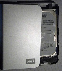 "Western Digital ""My Passport"" drive - sliding the drive away from the body."